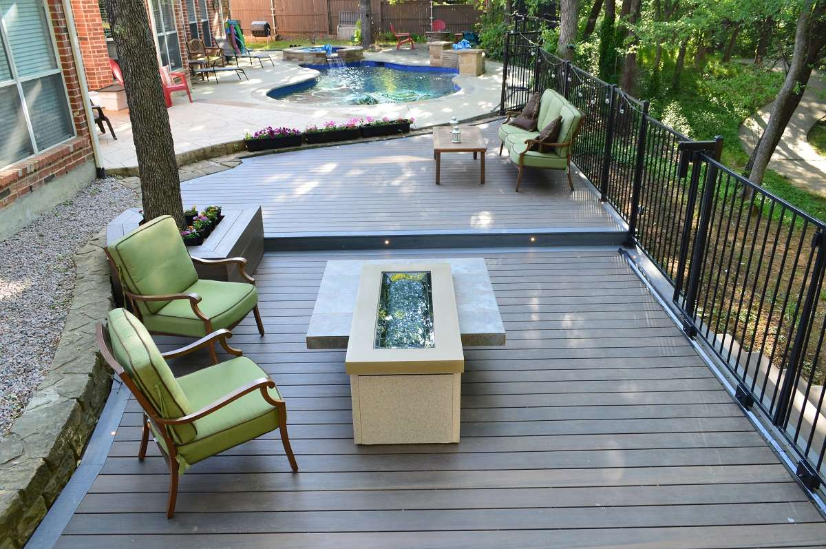 Outdoor poolside deck with furniture