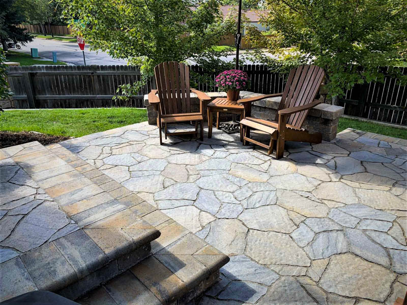 Stone patio with second level deck