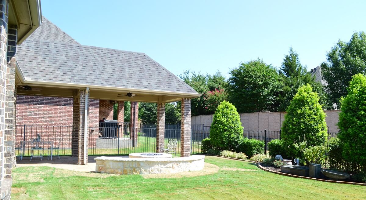 Custom-covered-patio-extension-and-custom-backyard-fire-feature-in-Colleyville
