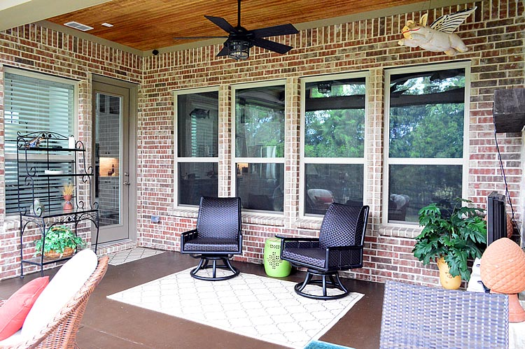 Covered screen patio with furniture