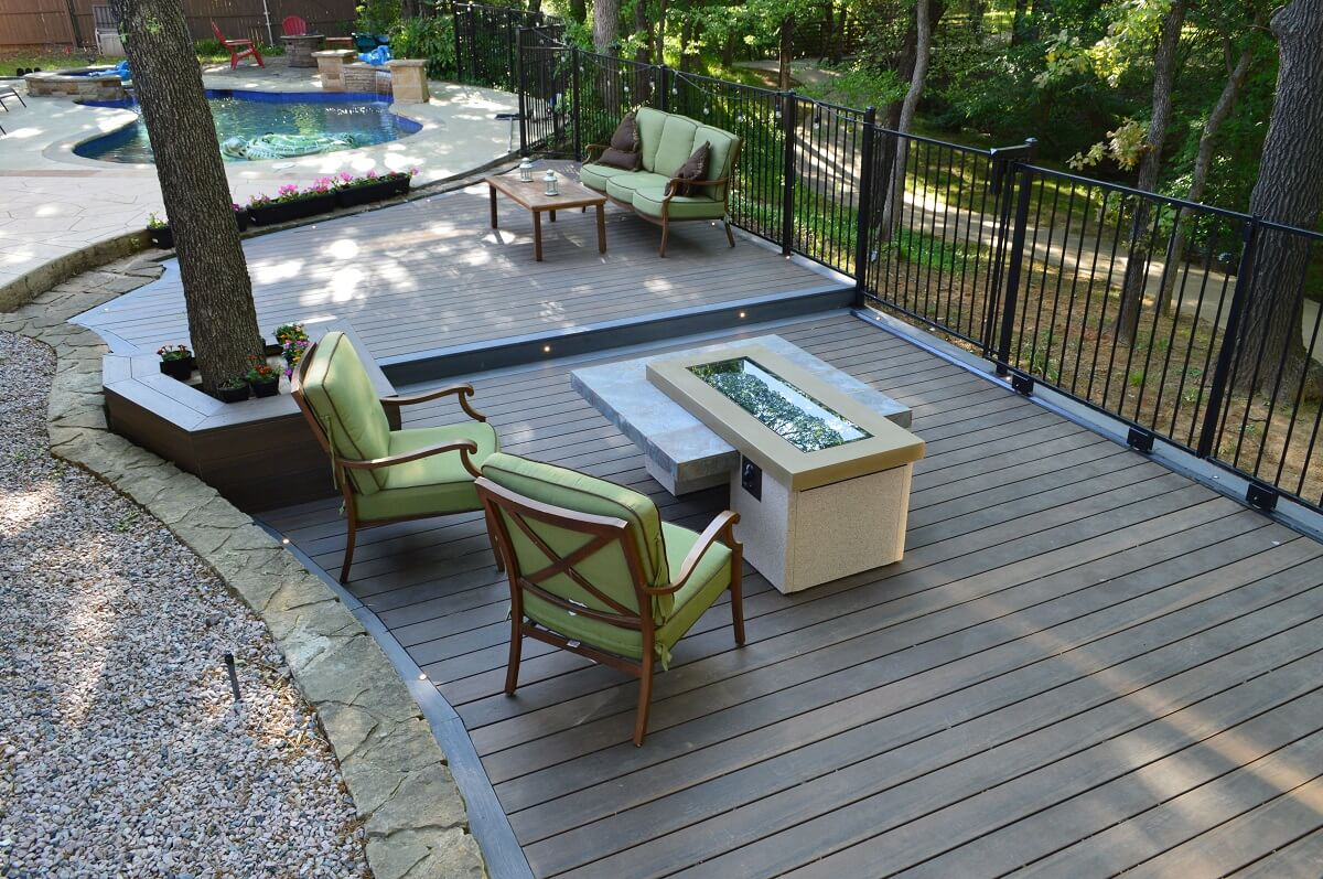 Custom poolside deck with fire pit area