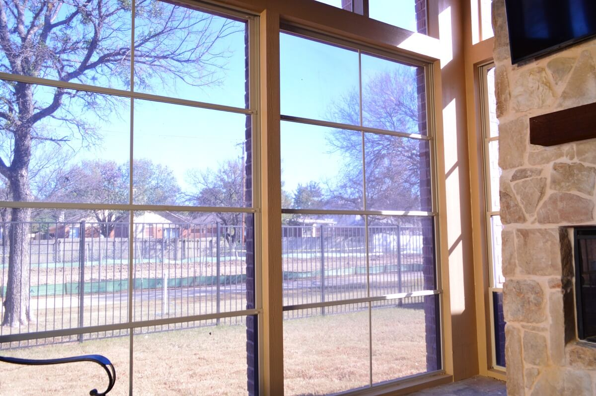 screened porch with wide windows