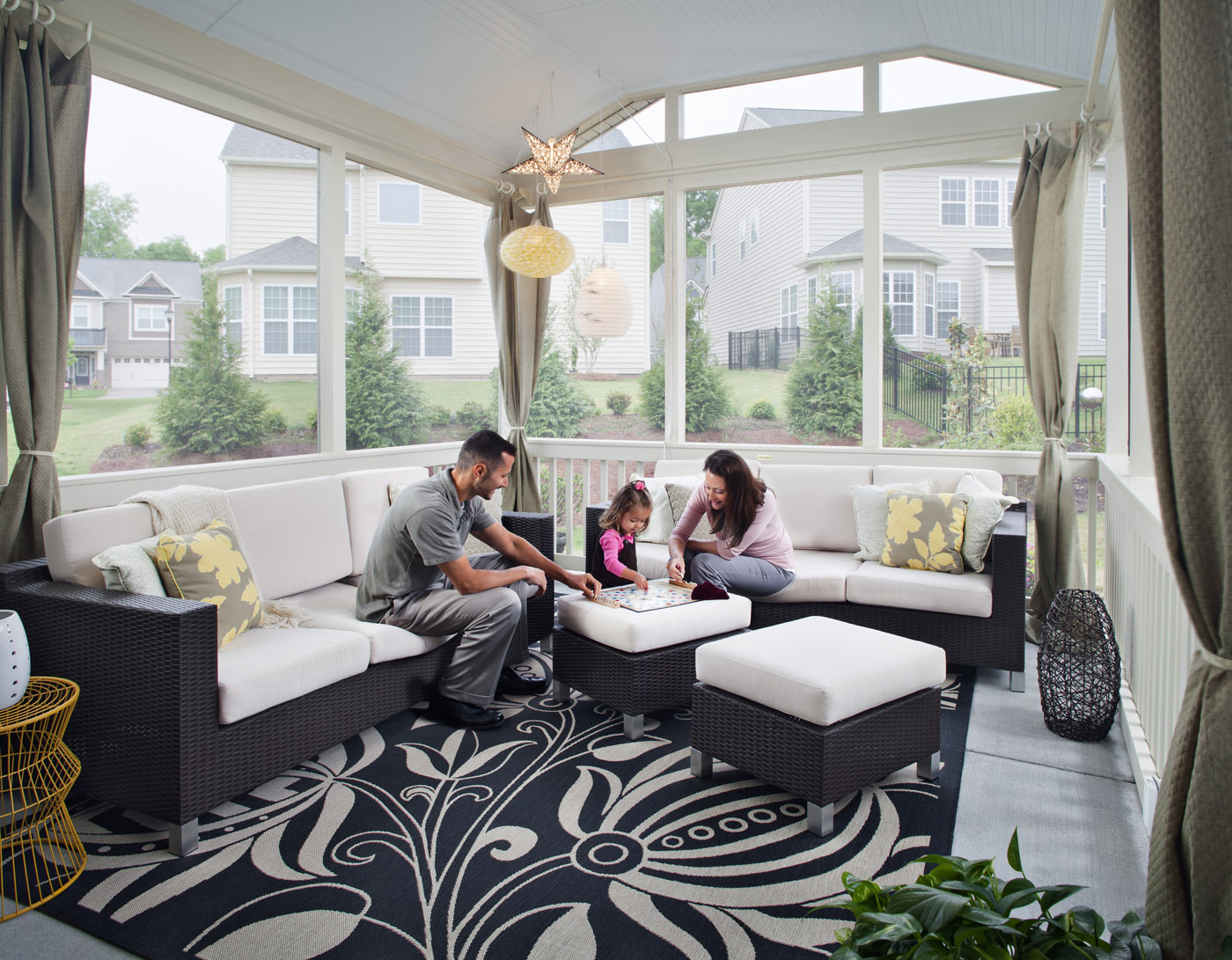 Family enjoying screened in porch