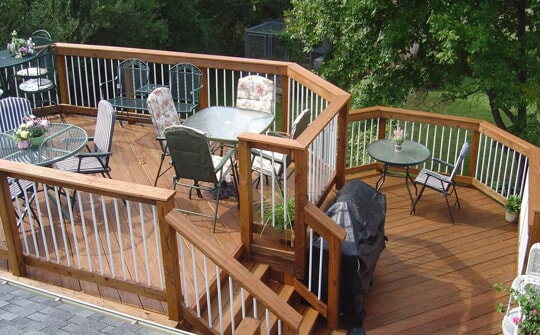 stained wood deck with white spindles