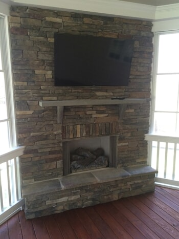 stacked stone porch fireplace
