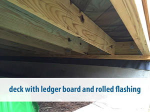 deck with ledger board and rolled flashing