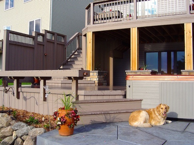 Custom patio with a dog in front