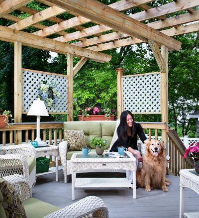 Woman and her dog relaxing under a pergola