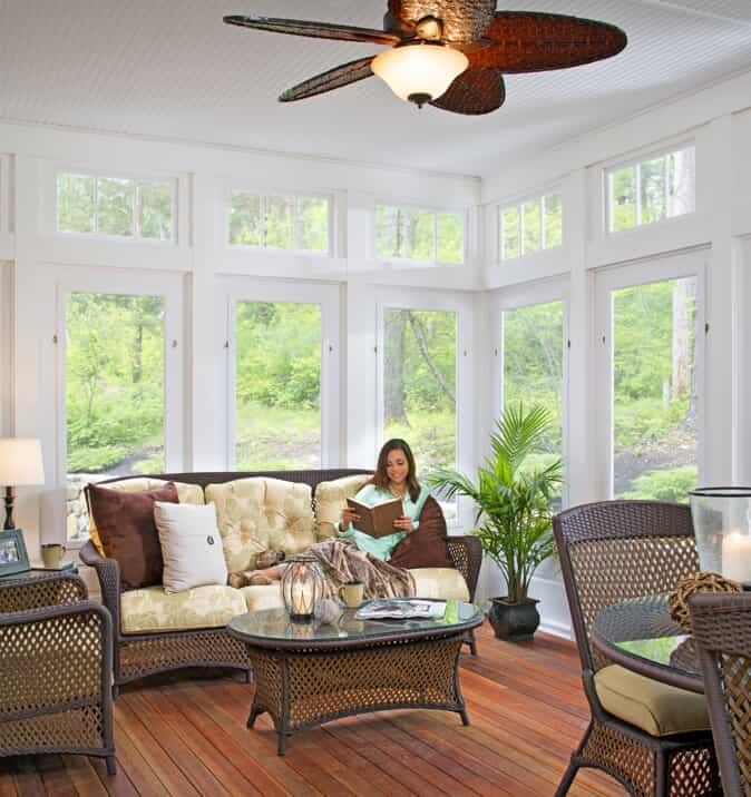 woman reading in sunroom