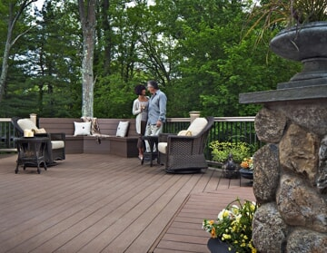 couple standing on composite deck