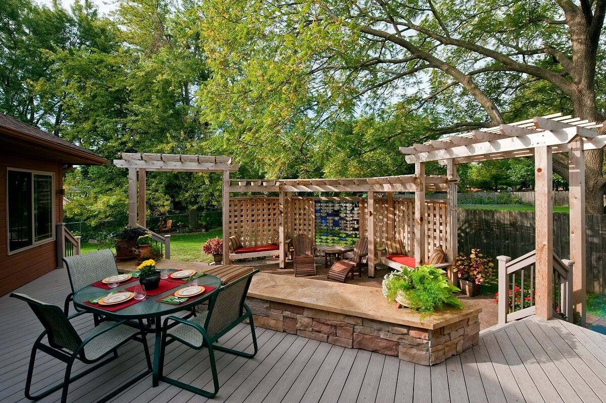 Deck and pergola with outdoor furniture and plants