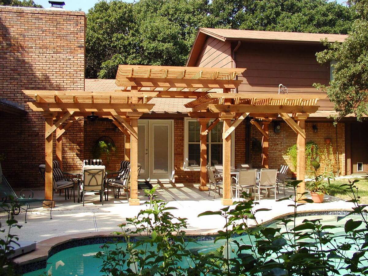 backyard poolside patio with pergola