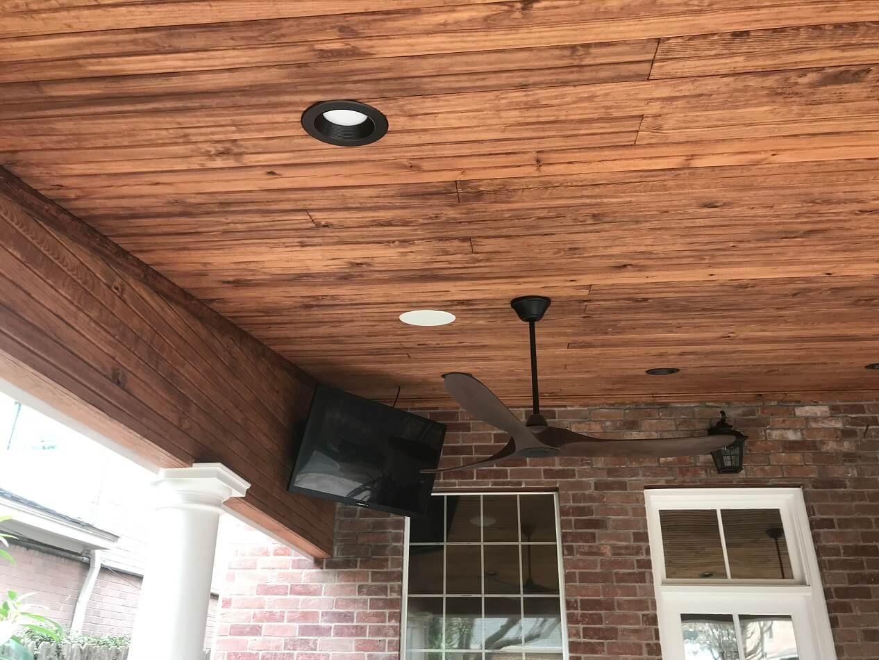 Covered patio with ceiling fan and TV