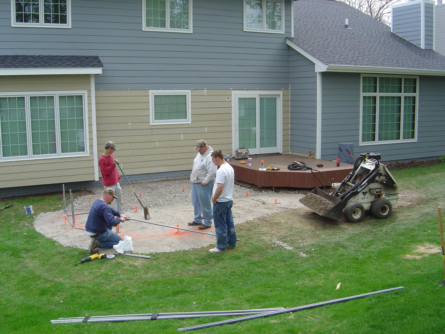 Archadeck employees working on a patio project