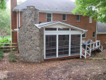 eze breeze porch with stone fireplace