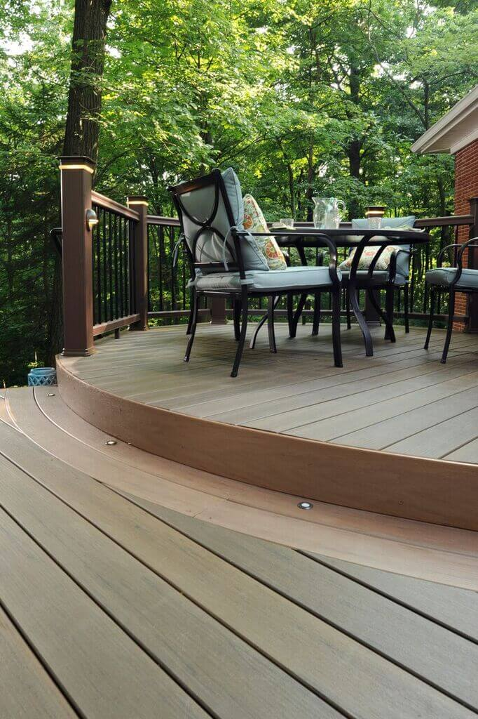 wood deck with railings and chairs