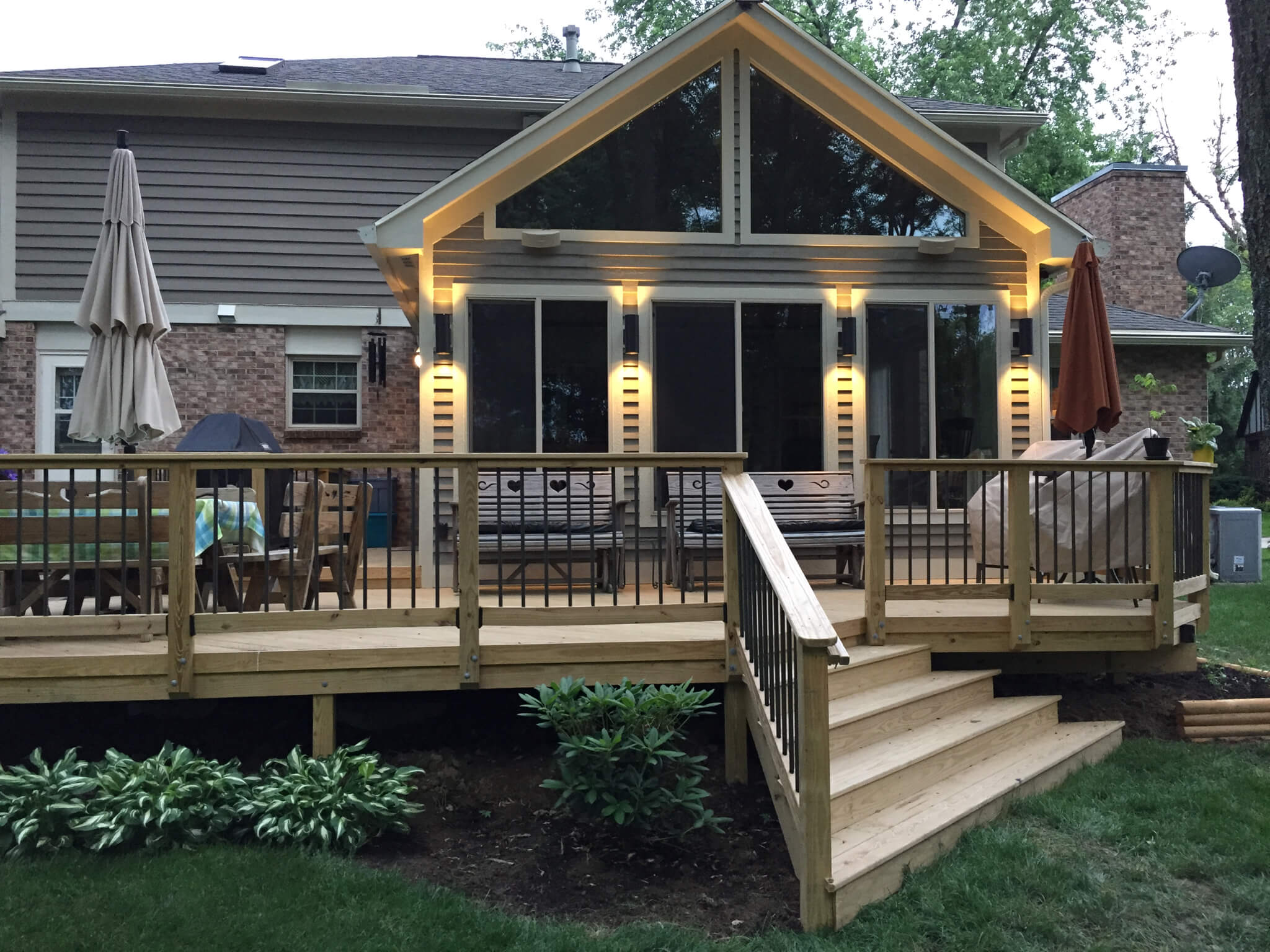 wood deck with railings and stairs