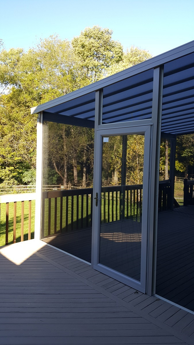 Natural Light patio cover with screen opens to uncovered deck