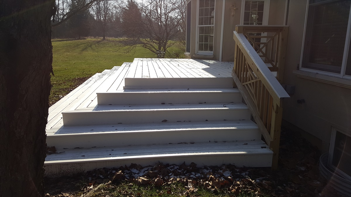Synthetic deck with wood southern cross railing