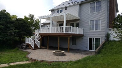 Backyard with two story deck and built in firepit