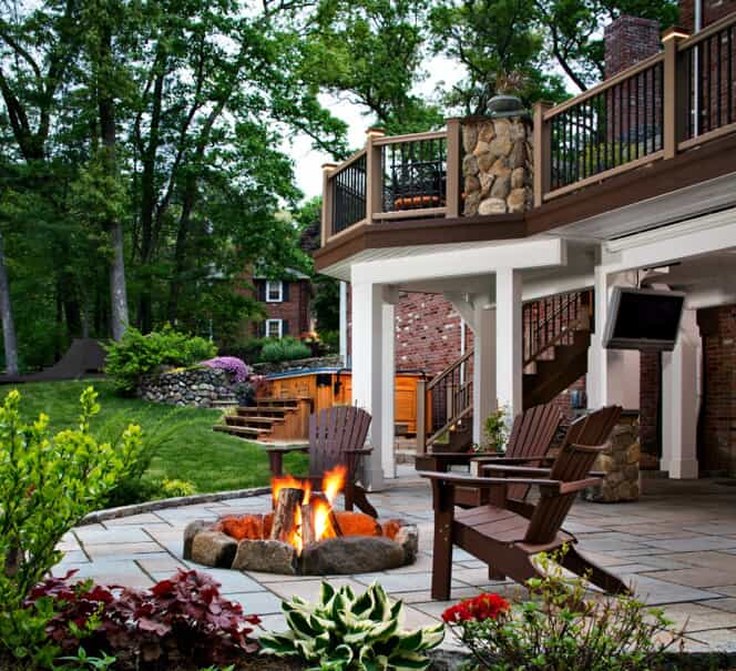 Backyard patio with firepit and deck