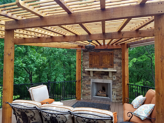 Deck with outdoor fireplace and pergola