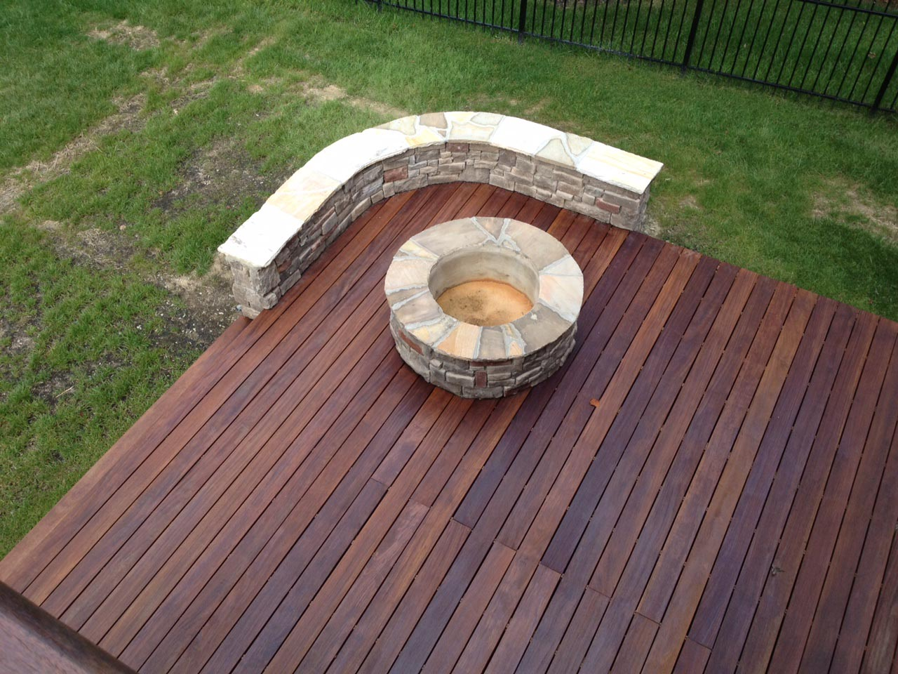 Fire pit with wooden deck