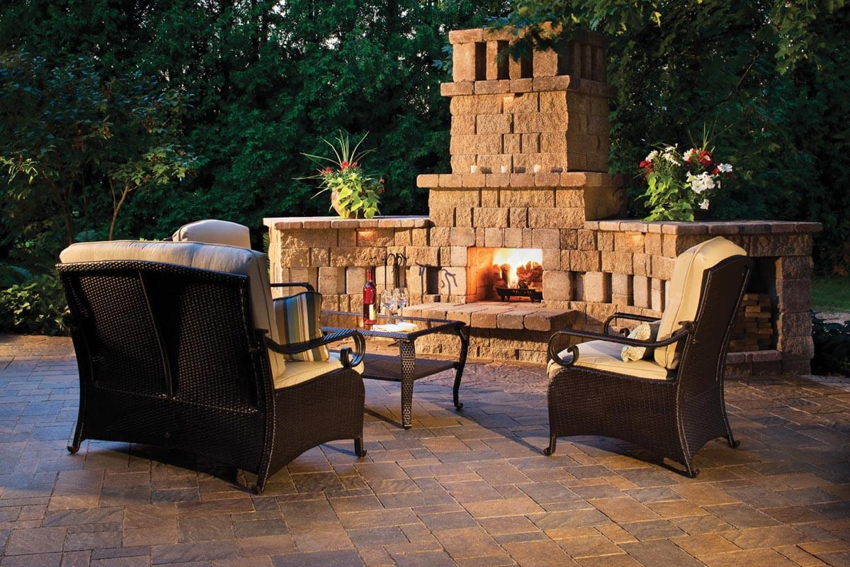 Patio with outdoor furniture and a fireplace