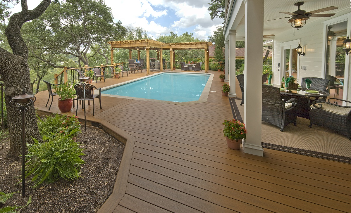 Low maintenance deck with seating area and pool in Houston