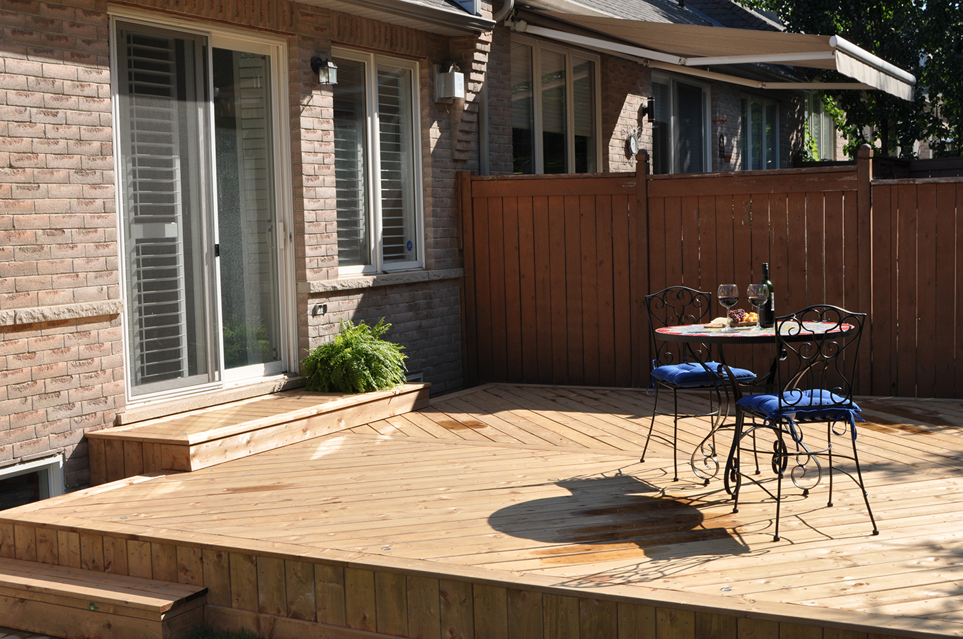 Wood deck with table and chairs.