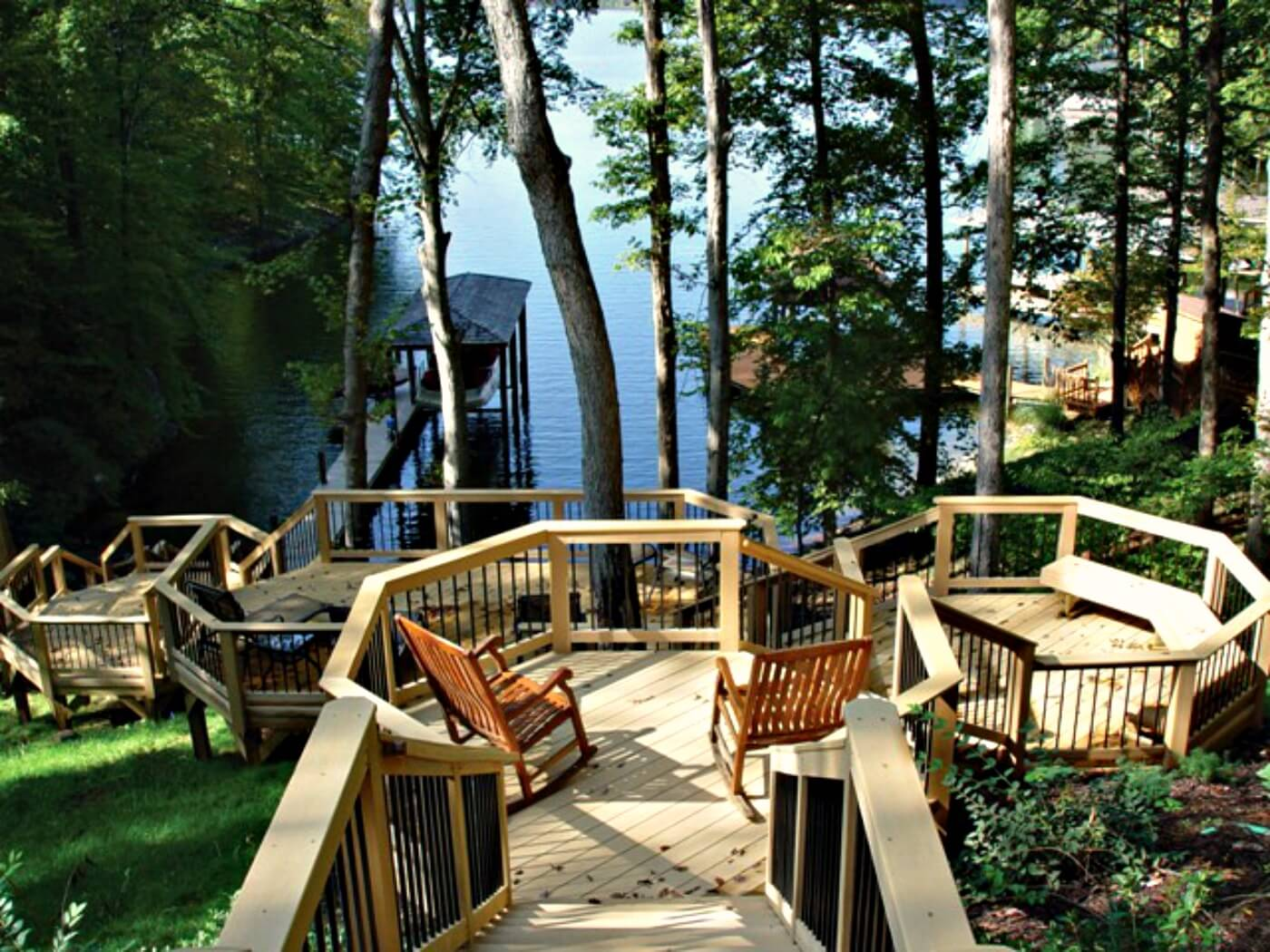 Custom multi-level lakeside deck with stairs and dock