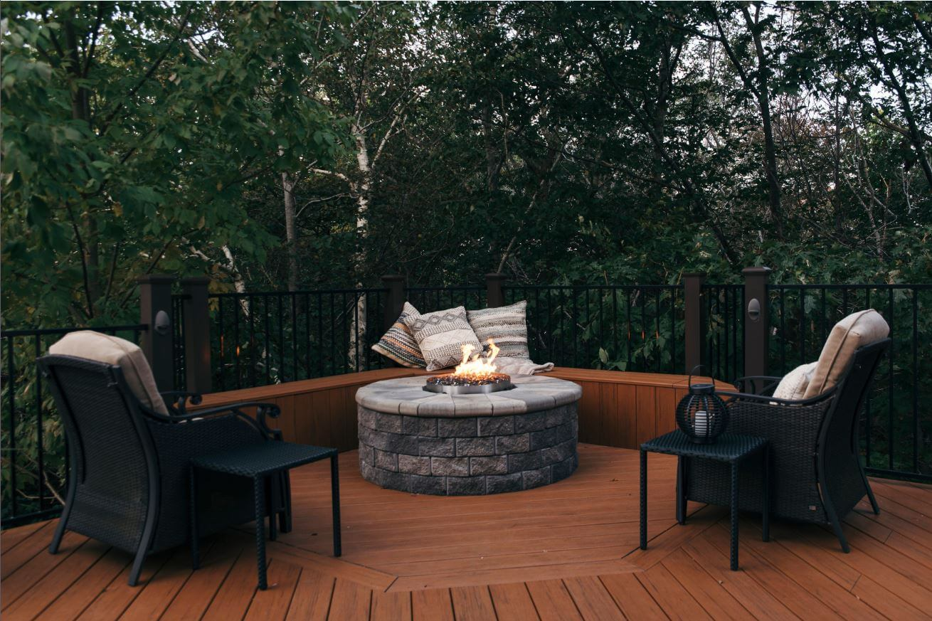 Composite deck and fire pit with unobstructed view of woodlands