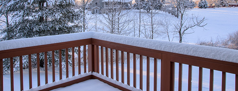deck railing with snow piling up