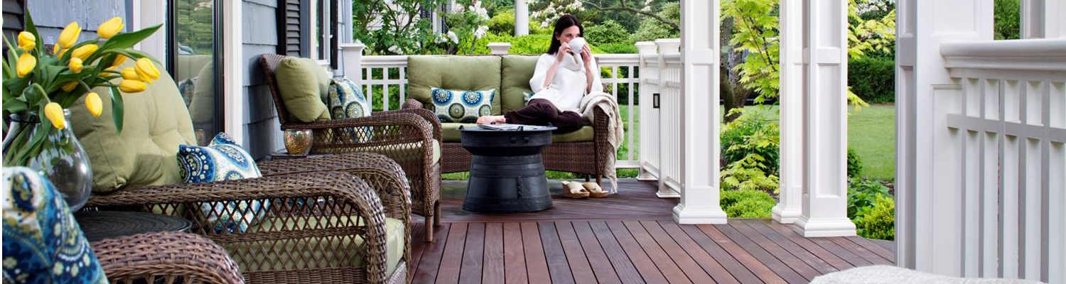 woman having coffee on cozy porch