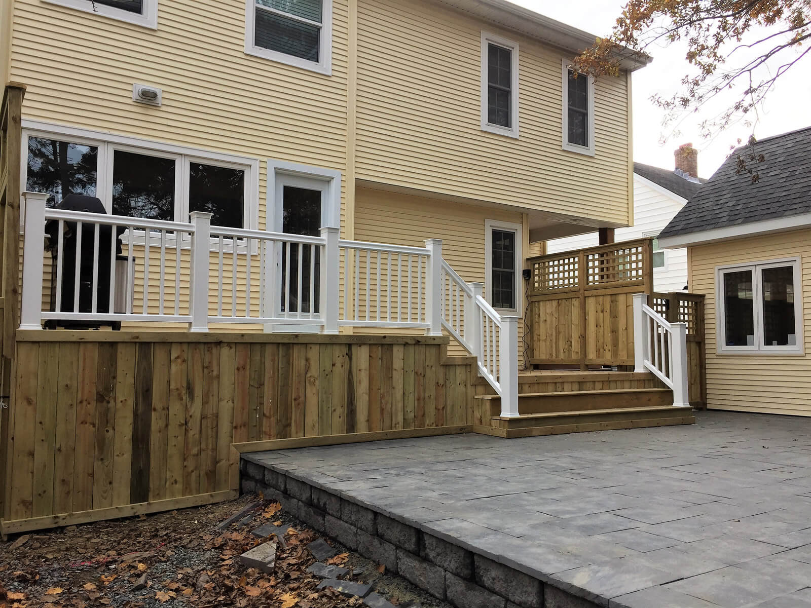 Outdoor wooden deck and hardscaped patio
