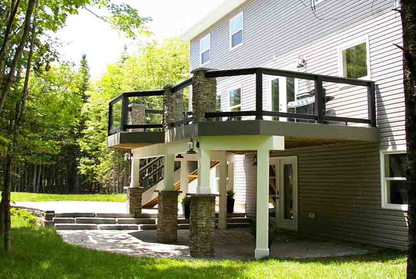 Custom elevated deck with stone columns