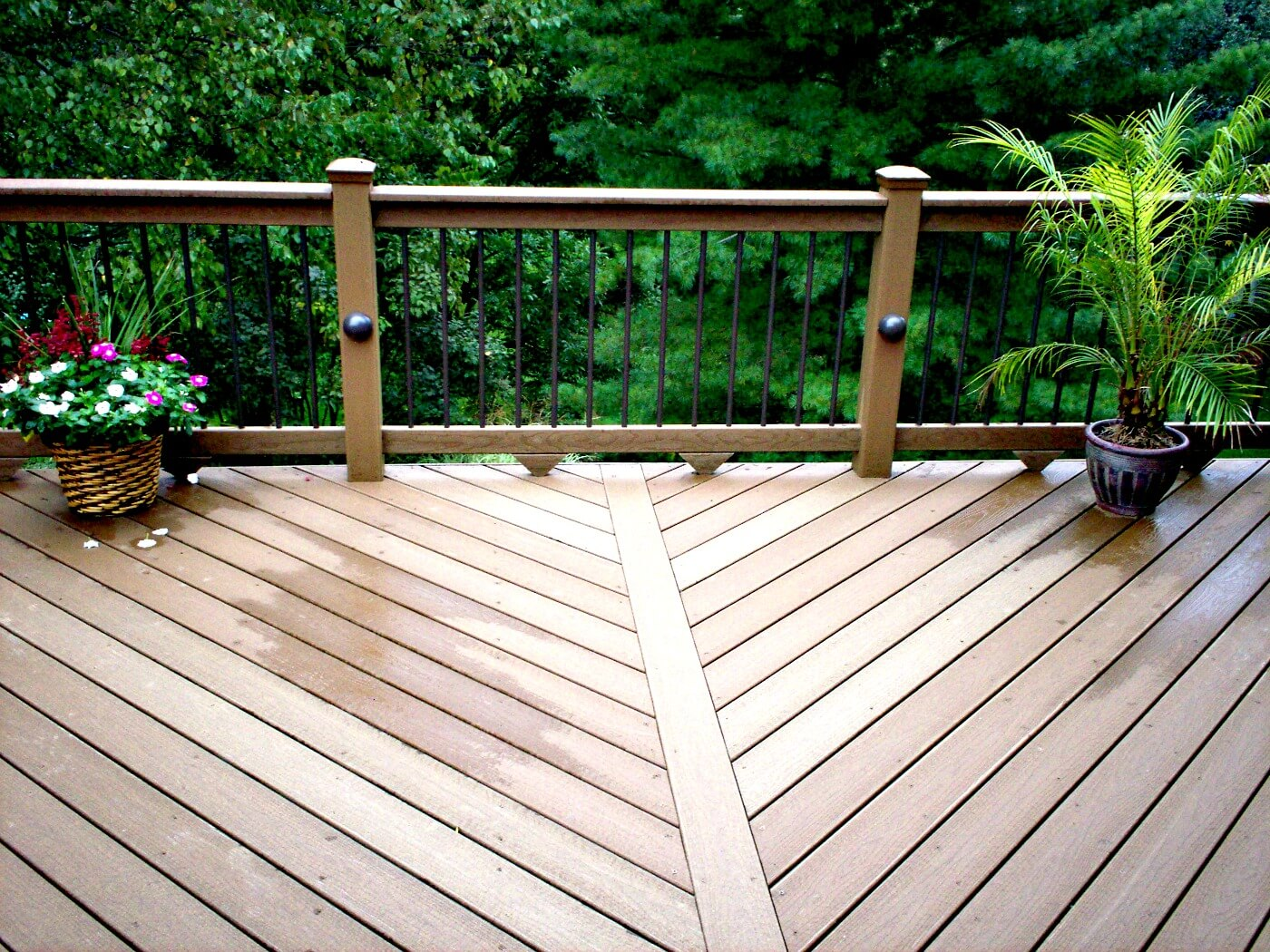 low maintenance composite deck with iron railing
