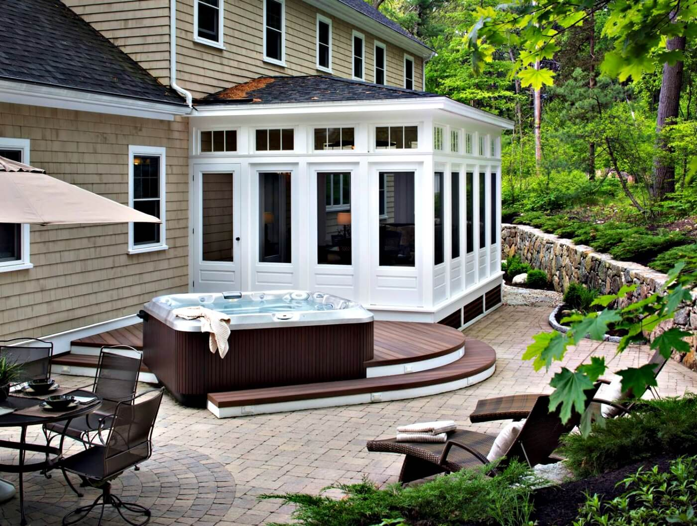 Sunroom and patio with hot tub deck