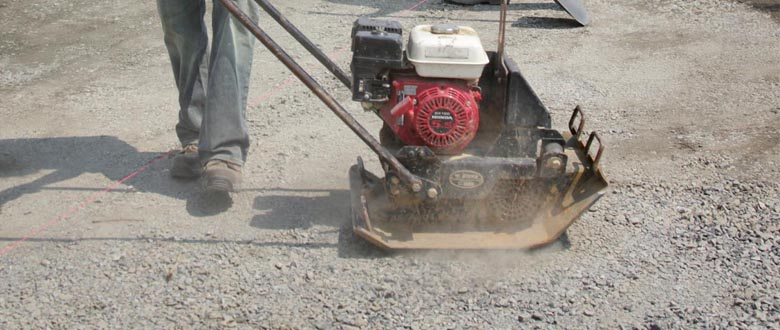 using a plate compactor to prepare for stone pavers
