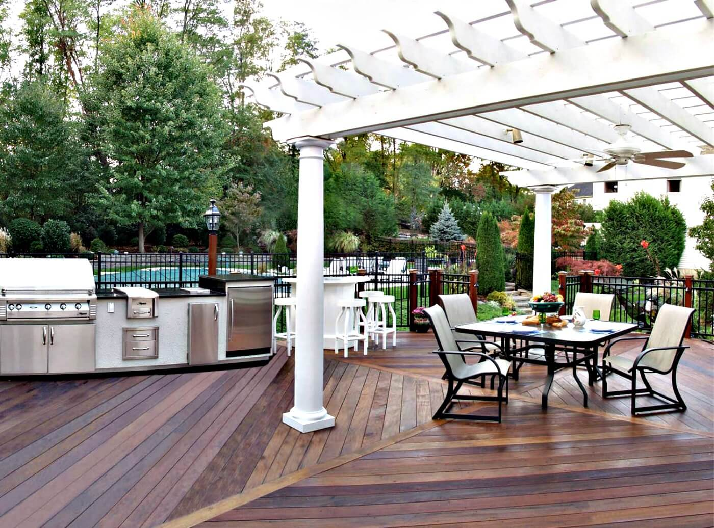 Custom deck with pergola and outdoor kitchen