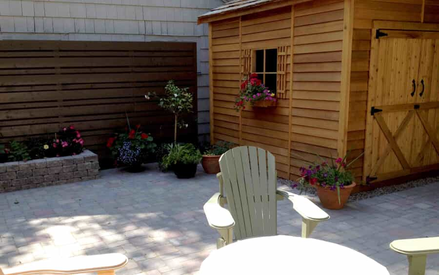 Stone patio with planter and shed