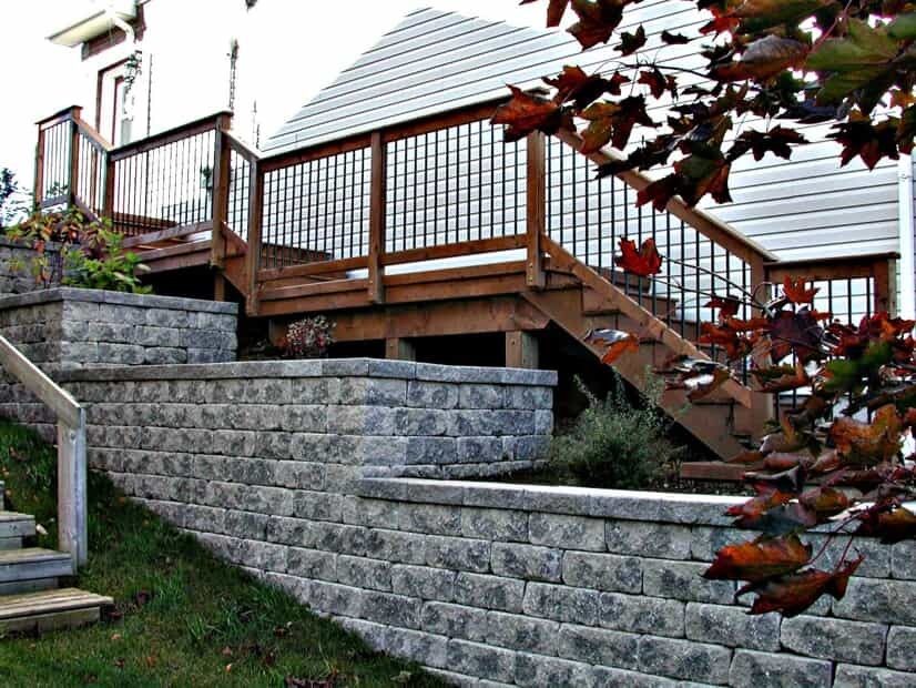 stone retaining wall next to wood stairs